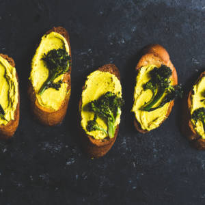 Roasted Broccoli and Turmeric Goat Cheese Crostini